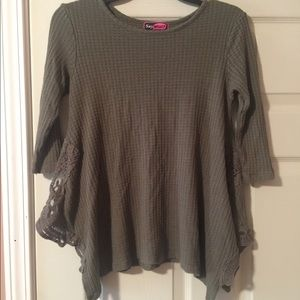 Cute olive shirt with lace on the sides. Like new!
